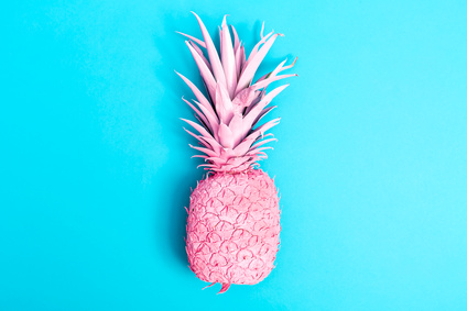 Pink pineapple on a blue background